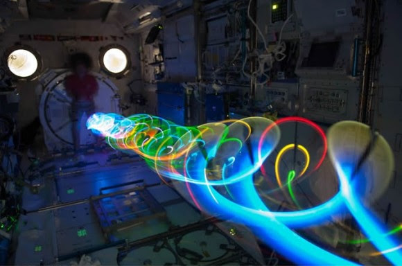 On Expedition 27 in May 2011, NASA astronaut Cady Coleman participated in the Auroral Oval Spiral Top experiment. Credit: NASA