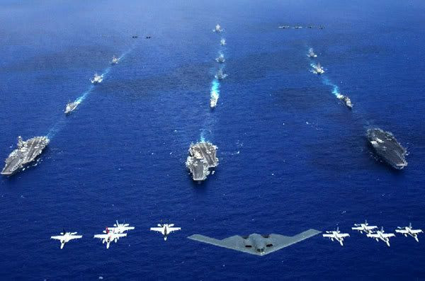A U.S. Air Force B-2 stealth bomber and 16 other aircraft from the Air Force, Navy, and Marine Corps fly over the USS Kitty Hawk, USS Ronald Reagan, and USS Abraham Lincoln carrier strike groups during a joint photo opportunity that kicked off exercise Valiant Shield, on June 19, 2006.