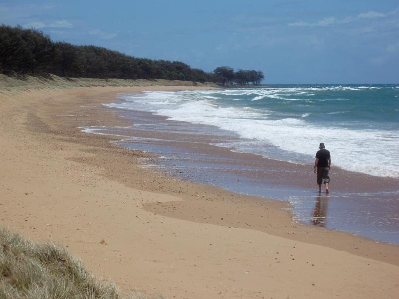 a relaxing walk in the surf is even better if you have the beach all to yourself