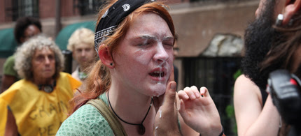 Kelly Schomburg, 18, receiving medical treatment after being pepper-sprayed by police, and mere moments before being arrested, 09/24/11. (photo: Occupy Wall Street)