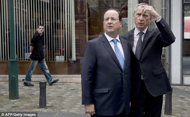 President Francois Hollande doesn't look too happy today