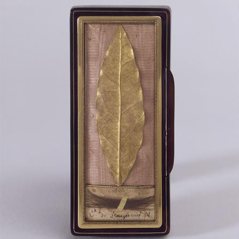 fapoleon-bonerparte:  Laurel leaf from the laurel wreath used at the coronation of Napoleon I. Mounted in a box frame. Gold. Circa 1804. Martin-Guillaume Biennais (1764-1843). [Source]