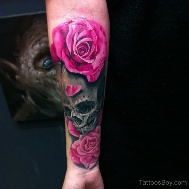 Pink Rose And Skull Tattoo On Wrist Tattoo Designs Tattoo Pictures