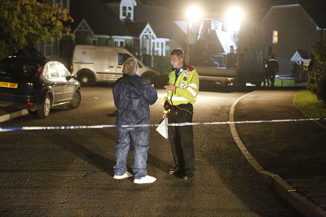 Villagers spoke of their shock at the horrendous crime. Pictured, police and forensics officers at the scene
