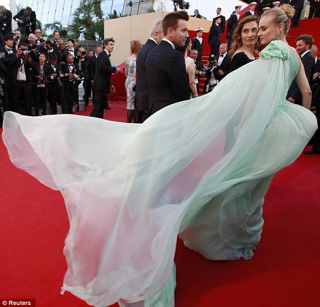 Old Hollywood glamour: Diane's gorgeous mint dress gathered into a corset, with a long cape-like swathe of translucent material falling from her left shoulder