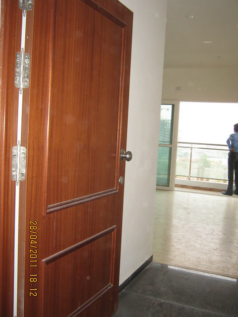 Main door, entrance lobby, living & balcony in a flat in Door holder in a flat in Sangria Towers at Megapolis Hinjewadi Phase 3, Pune