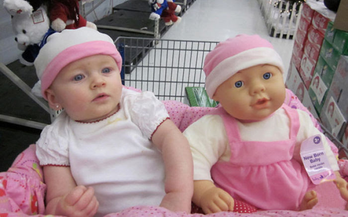 Baby And A Look Alike Doll