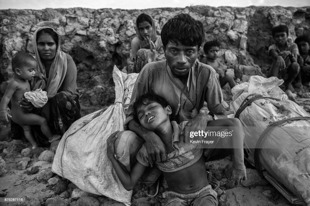 COX'S BAZAR, BANGLADESH - OCTOBER 30: A Rohingya Muslim refugee boy is held by his father after arriving by boat to Shah Porir Dwip on October 30, 2017 near Cox's Bazar, Bangladesh. More than 600,000 Rohingya refugees have flooded into Bangladesh to flee an offensive by Myanmar's military that the United Nations has called 'a textbook example of ethnic cleansing'. The refugee population continues to swell further, with thousands more Rohingya Muslims making the perilous journey on foot toward the border, or paying smugglers to take them across by water in wooden boats. Hundreds are known to have died trying to escape, and survivors arrive with horrifying accounts of villages burned, women raped, and scores killed in the 'clearance operations' by Myanmar's army and Buddhist mobs that were sparked by militant attacks on security posts in Rakhine state on August 25, 2017. What the Rohingya refugees flee to is a different kind of suffering in sprawling makeshift camps rife with fears of malnutrition, cholera, and other diseases. Aid organizations are struggling to keep pace with the scale of need and the staggering number of them - an estimated 60 percent - who are children arriving alone. Bangladesh, whose acceptance of the refugees has been praised by humanitarian officials for saving lives, has urged the creation of an internationally-recognized 'safe zone' where refugees can return, though Rohingya Muslims have long been persecuted in predominantly Buddhist Myanmar. World leaders are still debating how to confront the country and its de facto leader, Aung San Suu Kyi, a Nobel Peace Prize laureate who championed democracy, but now appears unable or unwilling to stop the army's brutal crackdown. During a recent visit to Myanmar, U.S Secretary of State Rex Tillerson called for a 'credible' probe into human rights violations against the Rohingya but said he would advise against full sanctions on the country.