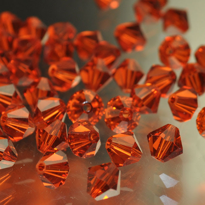2775301s37144 Swarovski Bead - 6 mm Faceted Bicone (5301) - Indian Red (1)