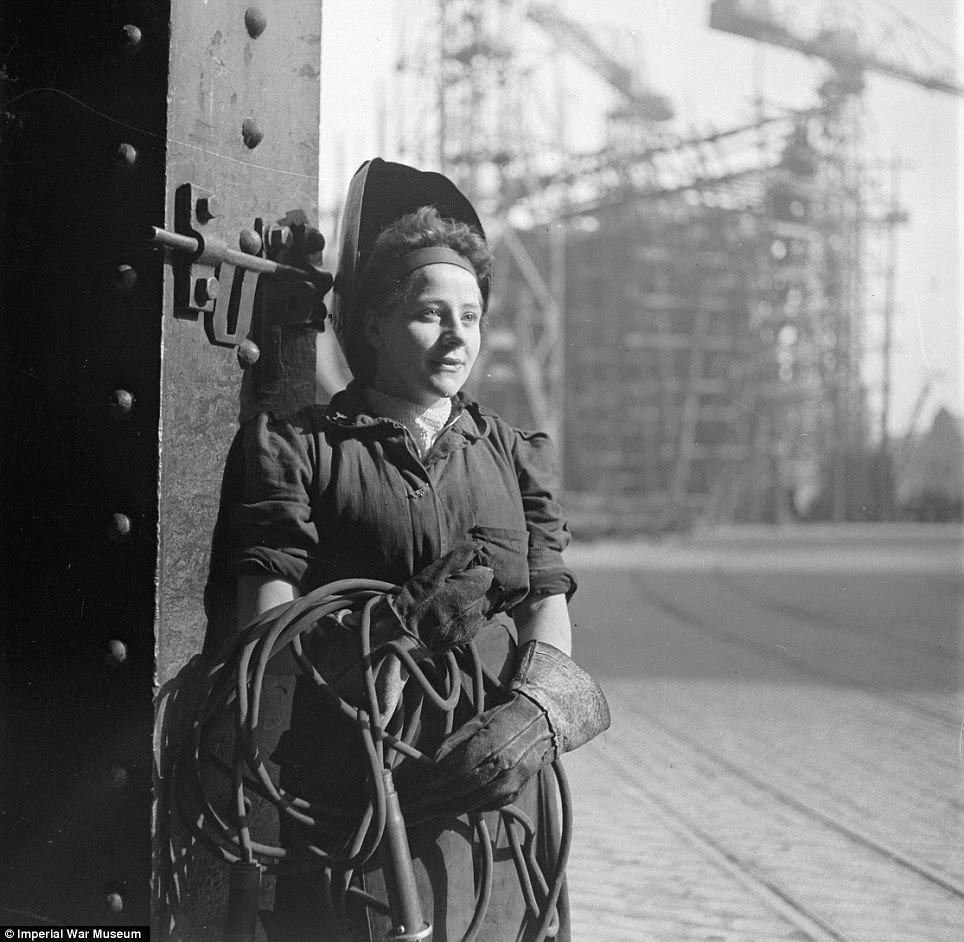 War effort: A female welder works on the deck of a new ship in Tyneside in 1943, in another expertly-composed Beaton photograph