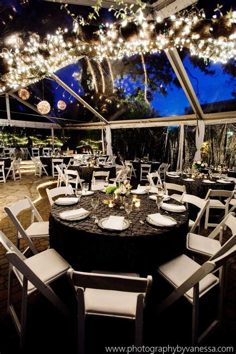 Beautiful nighttime wedding in an outdoor clear top tent