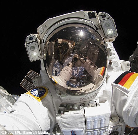 Spacewalk: A Russian cosmonaut takes a photograph during extravehicular activity (EVA) on the International Space Station on August 18
