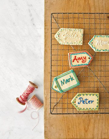 Sugar Cookie Name Tags  To create these sweet name tags, follow our recipe for sugar cookie dough. Form the cookies with a tag-shaped cutter, then use a plastic straw to punch a hole in the pointed end of each treat before baking