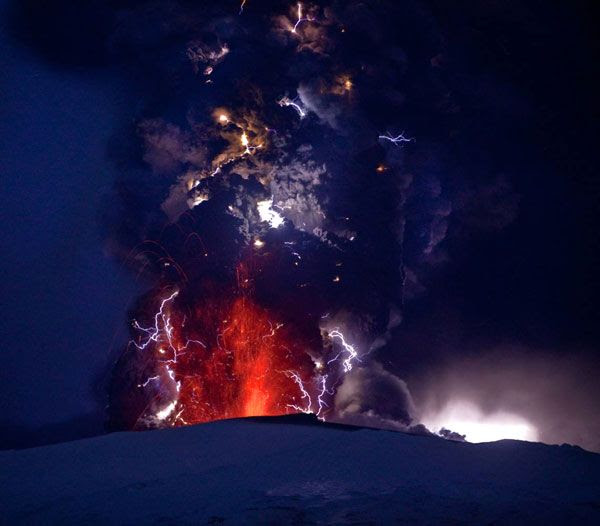 Lightning envelops a plume of ash that comes out of the Eyjafjallajokull volcano in Iceland, on April 17, 2010.