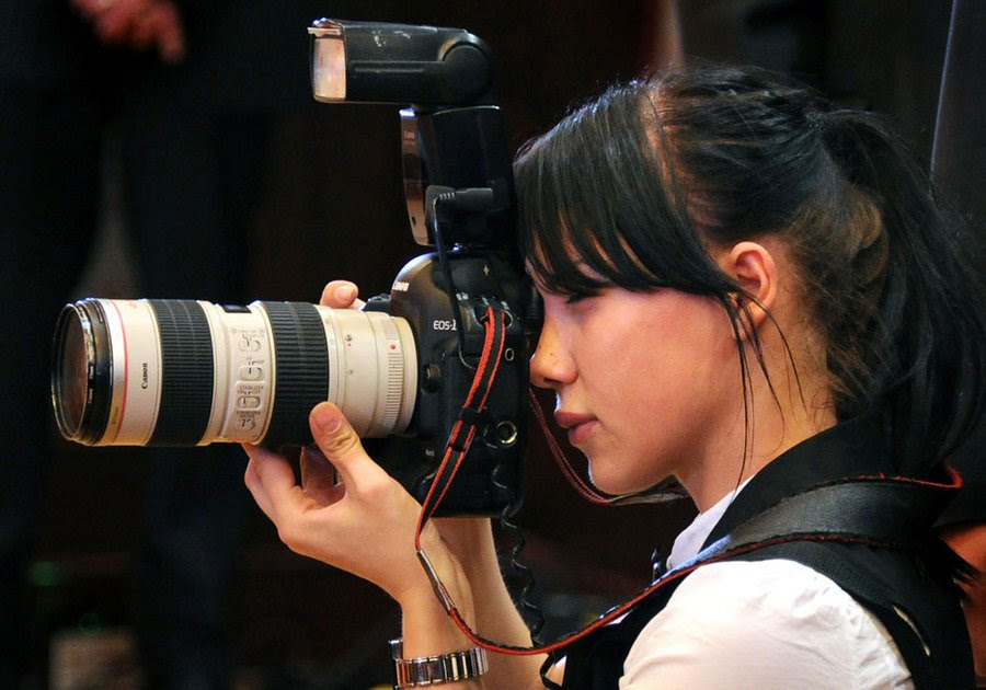 """Yana Lapikova, photographer of Russian President's shooting at an official meeting in Moscow, June 16, 2011 Job Lapikova, former model and finalist of the """"Miss Moscow"""" Putin's personal photographer caused a lot of comments on the Internet."""