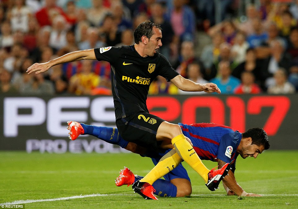 Barcelona's Luis Suarez and Atletico Madrid's Diego Godin pictured in action in the draw between the two sides