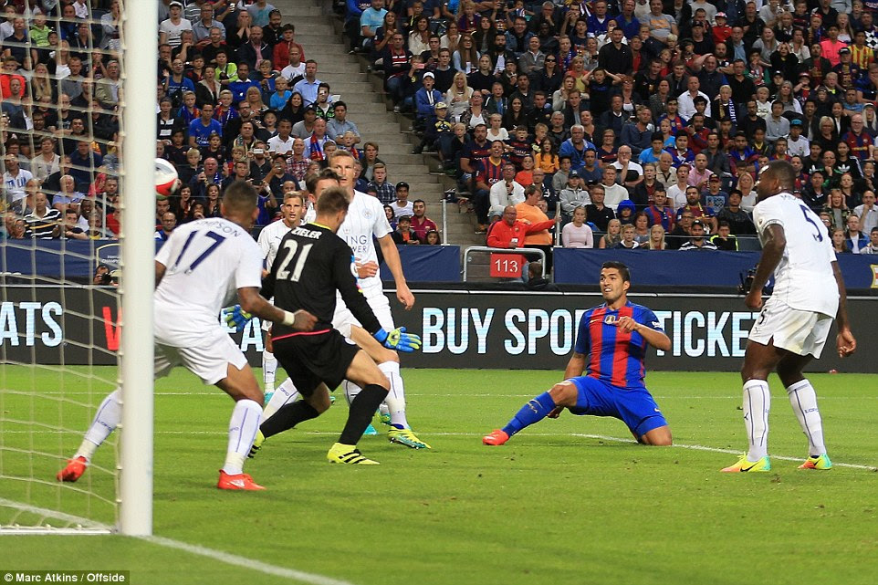 Luis Suarez doubles Barcelona's lead after beating two challenges and poking home from inside the six-yard box