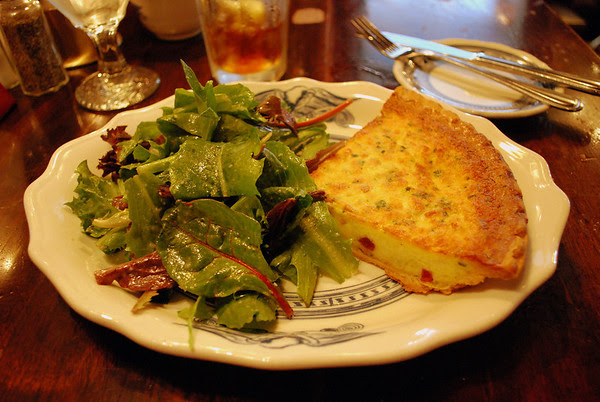 Country Ham and Gruyere Cheese Quiche with gathered greens and a vinaigrette dressing