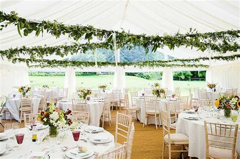 Fresh pretty wedding tent with marquee ceiling decoration