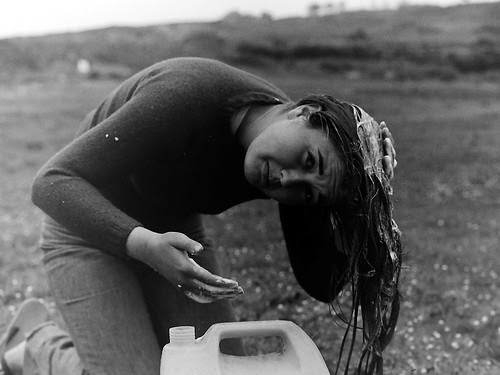 Girl washing hair Scilly Isles 1977