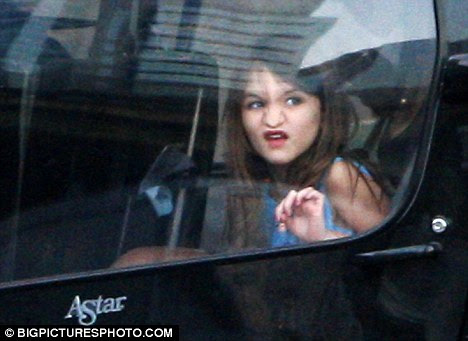 Playing around: Suri pushes her nose against the glass as she prepares to take off