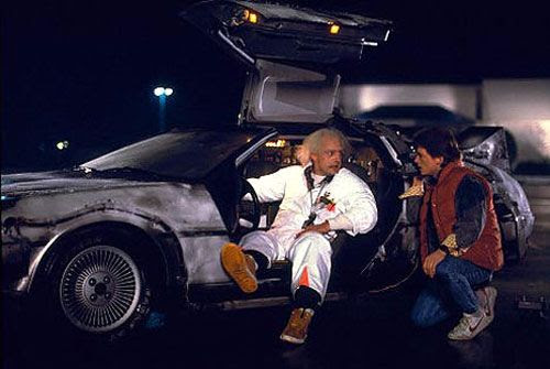 Doc Brown (Christopher Lloyd) and Marty McFly (Michael J. Fox) talk about time travel outside the Twin Pines Mall in BACK TO THE FUTURE.