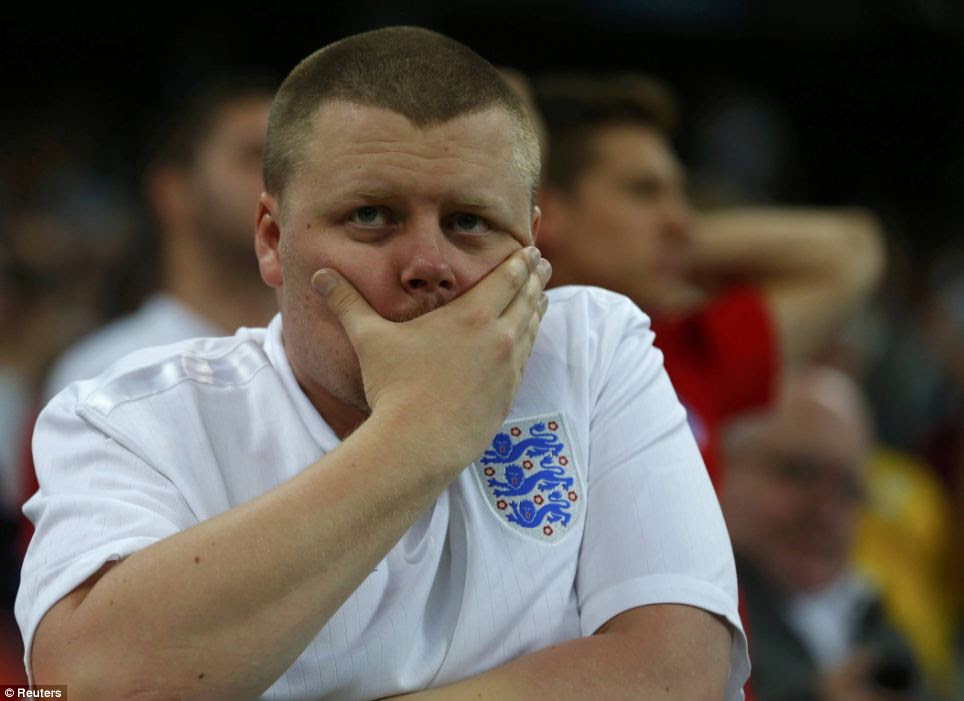 Not again: An England fan reacts at the end of the team's 2014 World Cup Group D soccer match against Uruguay