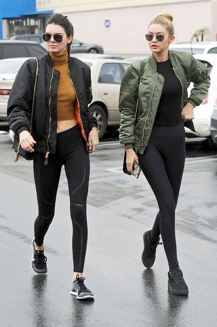 Le Fashion Blog Model Style Athleisure Trend Kendall Jenner GiGi Hadid Round Sunglasses Bomber Jacket Black Leggings Tee Shirt Turtleneck Crop Top Sneakers Via Harpers Bazaar