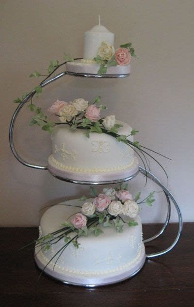 Two tier wedding cake displayed on 'S' shaped wedding cake