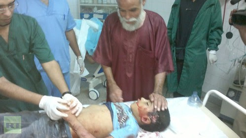 A child injured in Bani Walid, Libya when US-led rebels laid siege to the town slaughtering hundreds of civilians in one day. Obama boasts of the military destruction of this North African state. by Pan-African News Wire File Photos