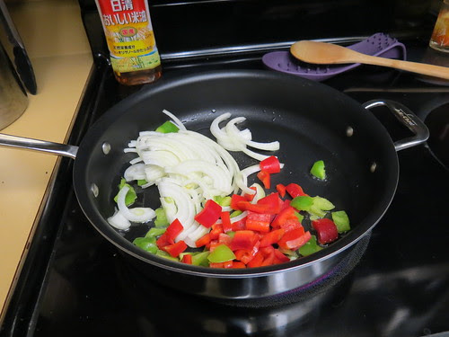onions and peppers in