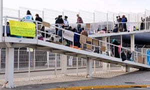 Syrian refugees block a walkway leading to the ferry terminal in Calais, France