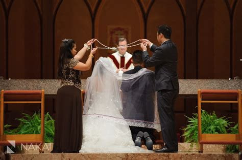 Filipino wedding tradition, the cord over bride and groom