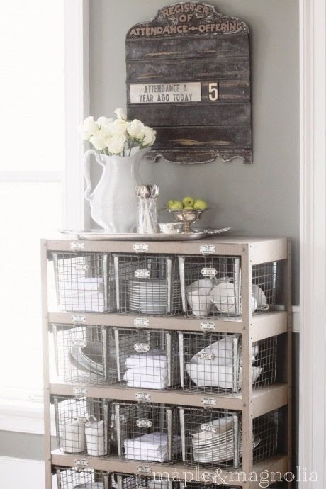 Old locker bins used to decoratively store white dishes...great open storage idea | Friday Favorites at www.andersonandgrant.com