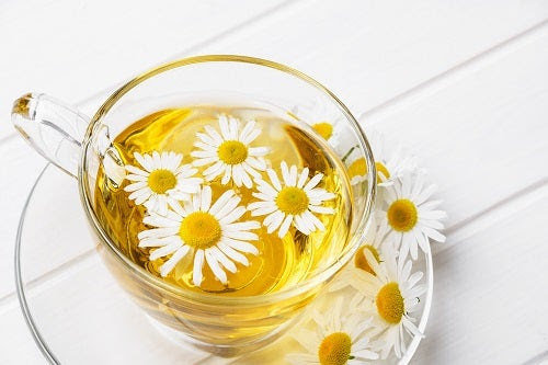 herbal chamomile tea on a white table
