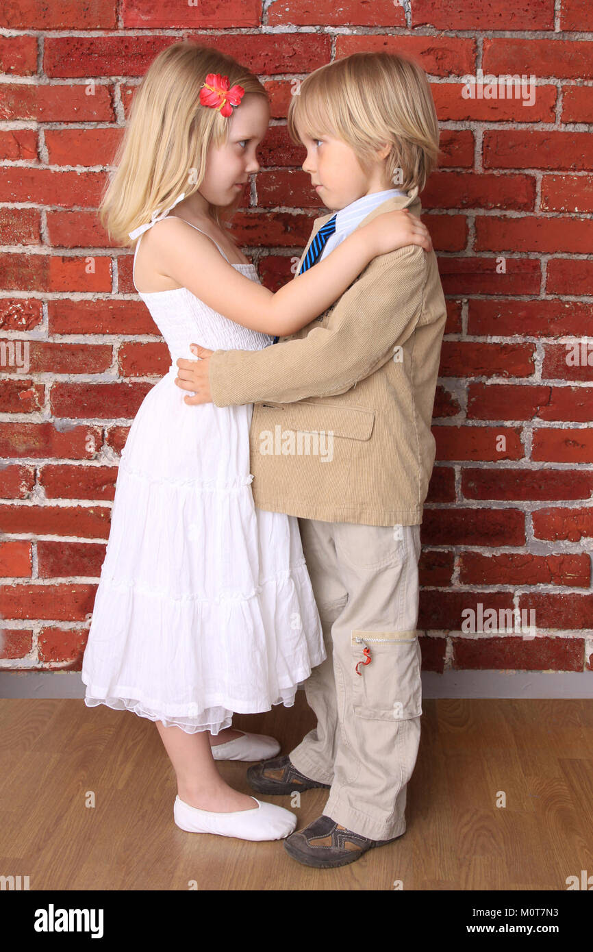 Little Boy Hugging A Beautiful Girl Love Concept Series Stock