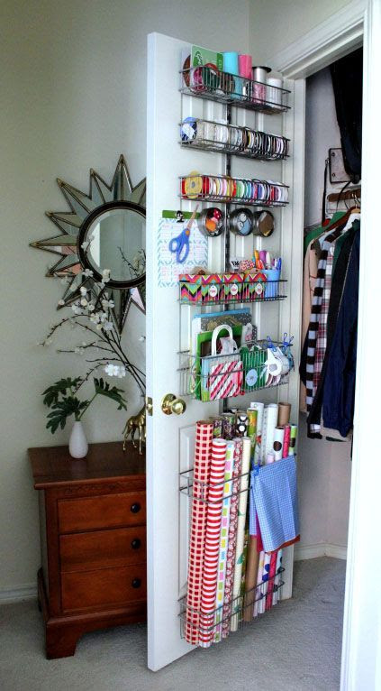 Gift Wrap Organization on the back of a door. - I love this idea!