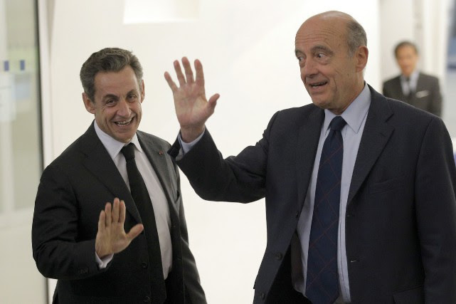 Nicolas Sarkozy et Alain Juppé.... (PHOTO CHRISTOPHE ENA, ARCHIVES ASSOCIATED PRESS)