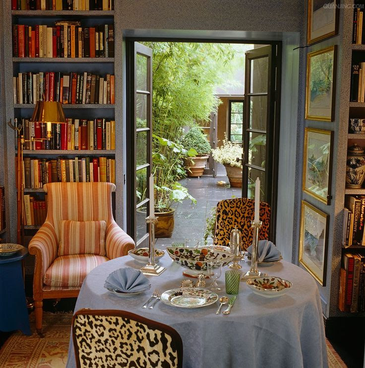elegant animal print accented library and dining room by John Stefanidis design