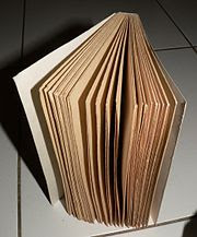 An uncut book; the pages must be separated before reading
