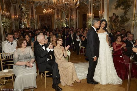 George Clooney gazes at wife Amal in wedding shots from