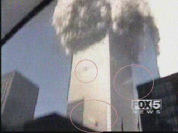 http://911research.wtc7.net/wtc/evidence/photos/docs/south_tower_squibs.jpg