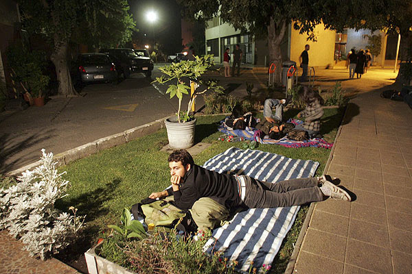 People try to rest on the streets at Santiago, Chile