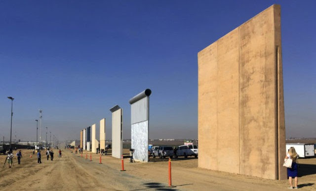 This Oct. 26, 2017 file photo shows prototypes of border walls in San Diego. Rigorous testing of prototypes of President Donald. A U.S. official says recent testing of prototypes of President Donald Trump's proposed wall with Mexico found their heights should stop border crossers. U.S. tactical teams spent three weeks trying to breach and scale the models in San Diego. An official with direct knowledge of the results said they point to see-through steel barriers topped by concrete as the best design. The official spoke to The Associated Press on condition of anonymity because the information is not authorized for release. (AP Photo/Elliott Spagat, File)