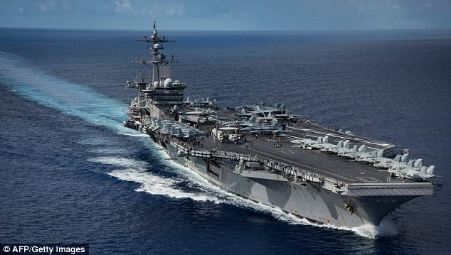The Nimitz-class aircraft carrier USS Carl Vinson (CVN 70) as it transits the Philippine Sea while conducting a bilateral exercise with the Japan Maritime Self Defense Force in the Philippine Sea, the military exercises referred to by the North Korean ministry