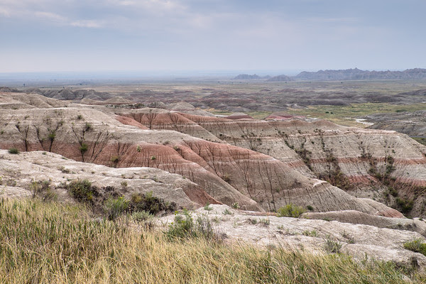 layers of red and cream-colored rock, at Badlands National Park