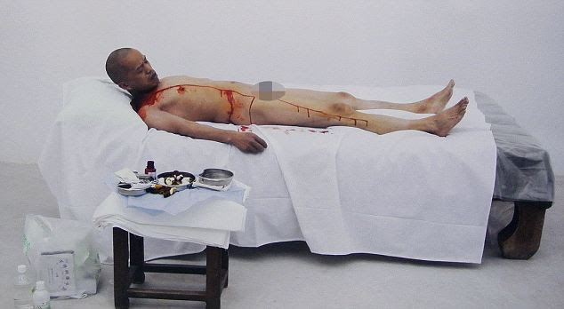 Body of work: In order to perform the operation, He Yunchang performed under the supervision of a doctor, he cut a metre-long gash, from his neck to his thigh, and filmed it on a camera