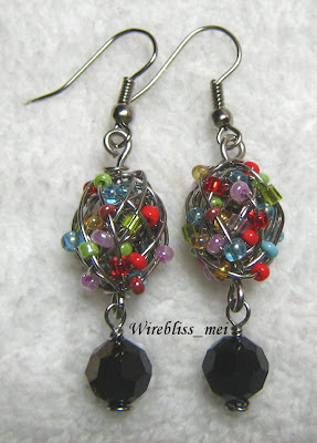sead beads coiled with fine stainless steel wire to form beaded beads for earrings