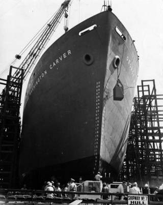 black and white prow of ship with people, scaffolding