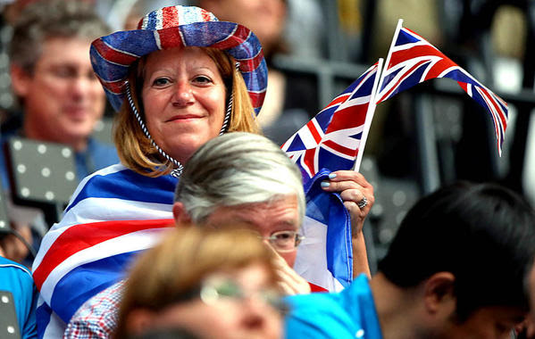 A fan shows her British pride at the opening ceremony for the 2012 London Olympics at Olympic Stadium on Friday.
